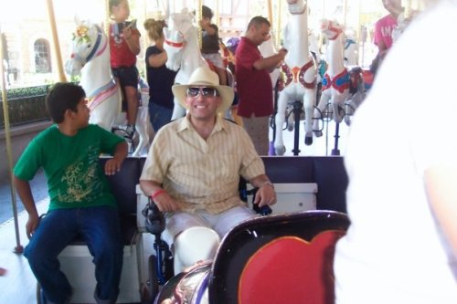 There are about ten attractions at Disneyland that allow for a wheelchair-bound guest to literally roll across a ramp and onto the ride. This is one such example of me on the carousel.