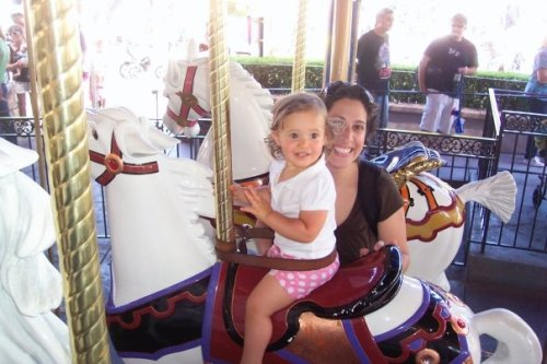 Once inside the park, our first ride was on King Arthur's Carousel. Seemingly happy now, Emma's face told a vastly different story once the ride started.